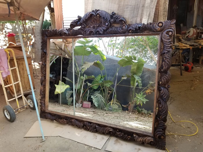 mirror with elaborate frame
